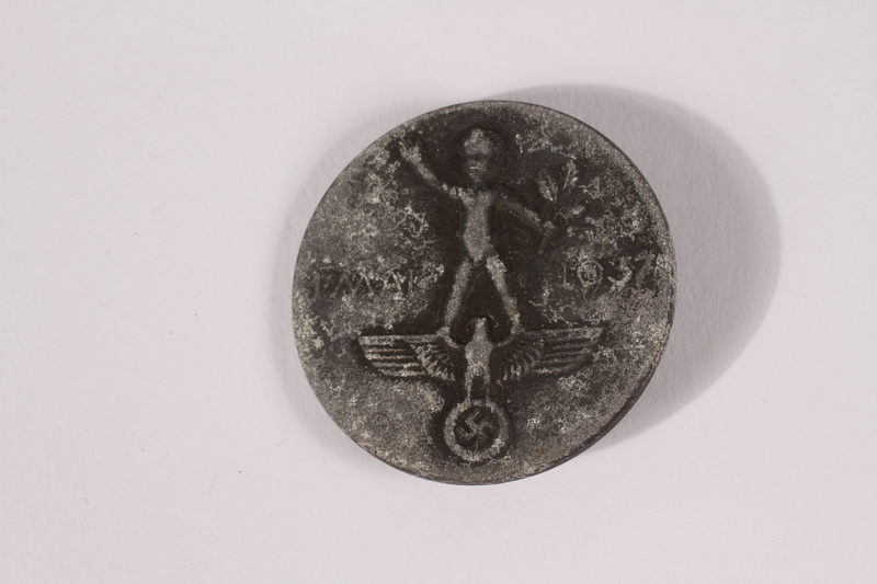 2014.480.49 front 1937 May Day pin with the Nazi eagle insignia acquired by a US soldier