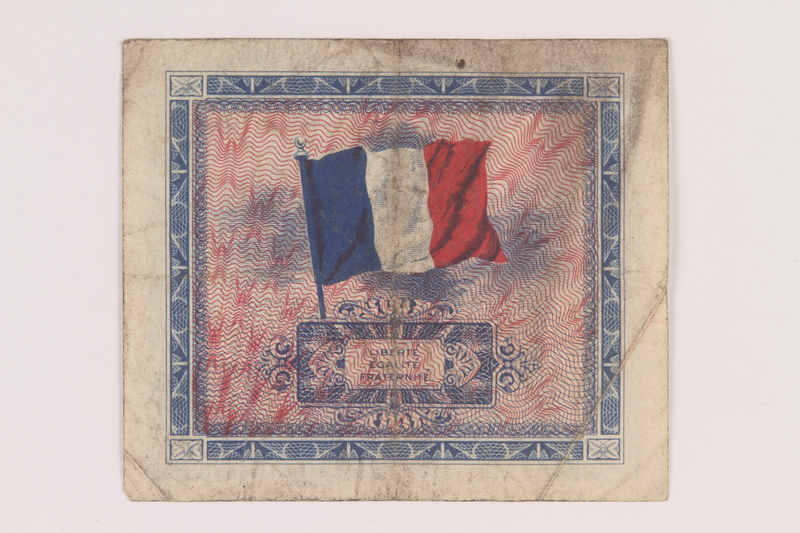 2013.442.18 back Allied Military Authority currency, 5 francs, for use in France, acquired by a US soldier