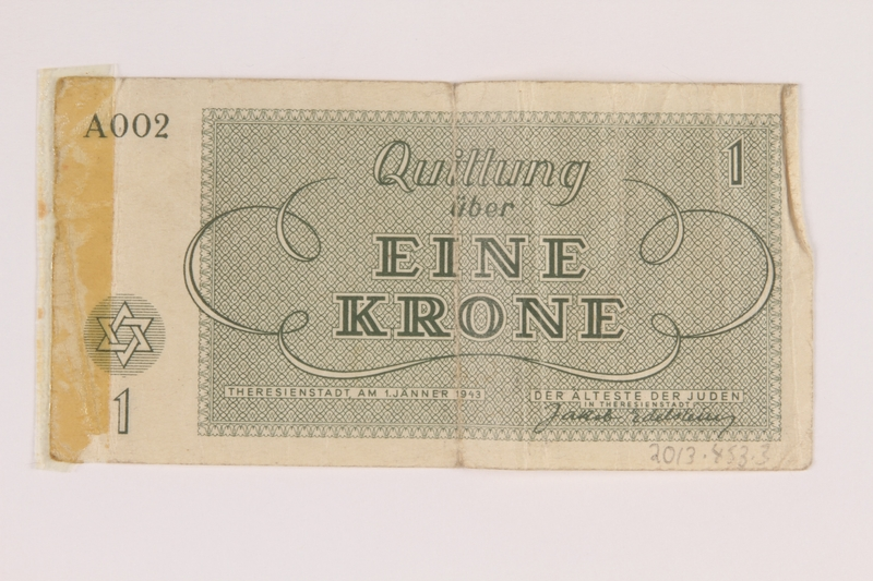 2013.453.3 back Theresienstadt ghetto-labor camp scrip, 1 krone note, acquired by a US soldier