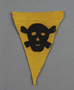 Small, yellow warning pennant with a skull and crossbones acquired by a US soldier