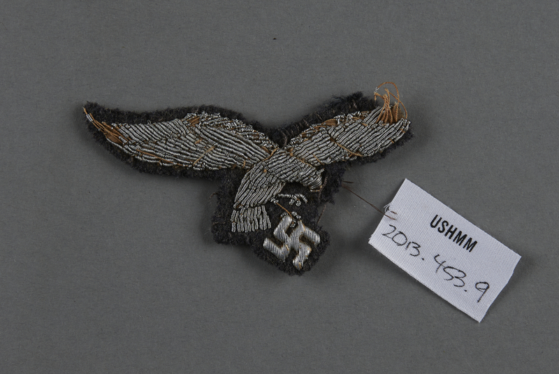 2013.453.9 front Luftwaffe officer's insignia with embroidered silver wire eagle and swastika acquired by a US soldier