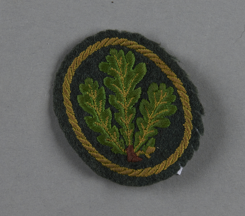 2013.453.11 front German Army, Jager Regiment, Brandenburg Division, sleeve insignia with embroidered oak leaves acquired by a US soldier
