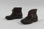 Pair of child's brown leather ankle boots received by girl in DP camp