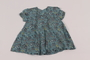 Child's flowered blue dress received by girl in DP camp
