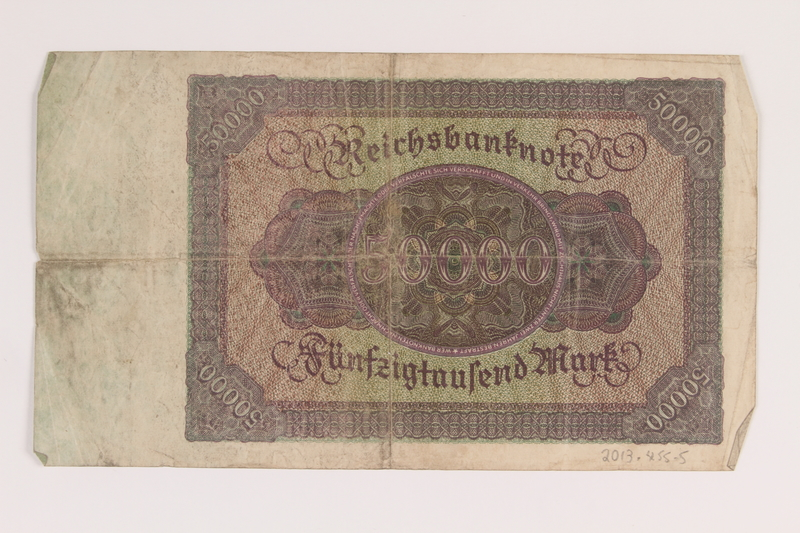 2013.455.5 back Weimar Germany, 50000 mark note, from the album of a Waffen-SS officer acquired by an American soldier