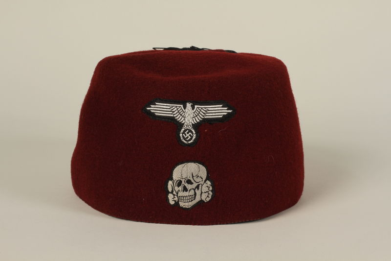 1994.101.1 front Waffen SS red fez acquired by a US soldier in Germany