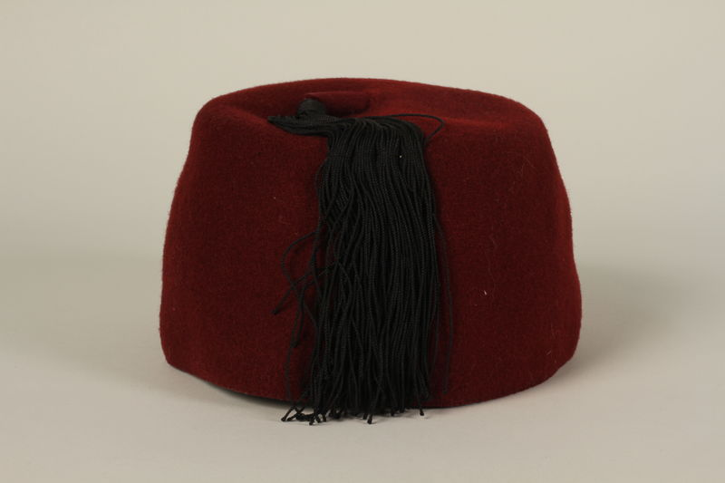 1994.101.1 back Waffen SS red fez acquired by a US soldier in Germany