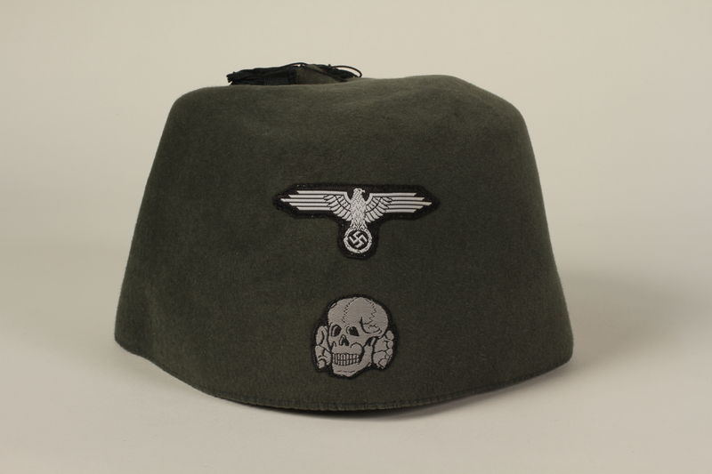 1994.101.2 front Waffen SS green fez found in Dachau by a US soldier