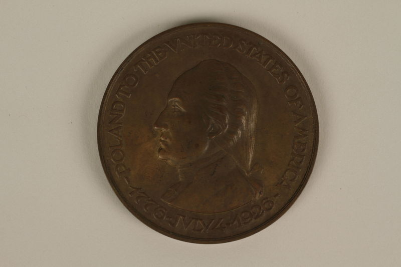 1994.114.3.1 back Poland in Tribute to the United States of America medal by J. Aumiller