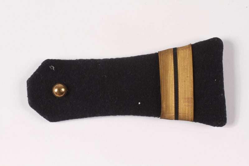 2009.410.4_a top Pair of dark blue shoulder boards with gold bars