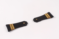 2009.410.4_a-b top Pair of dark blue shoulder boards with gold bars  Click to enlarge