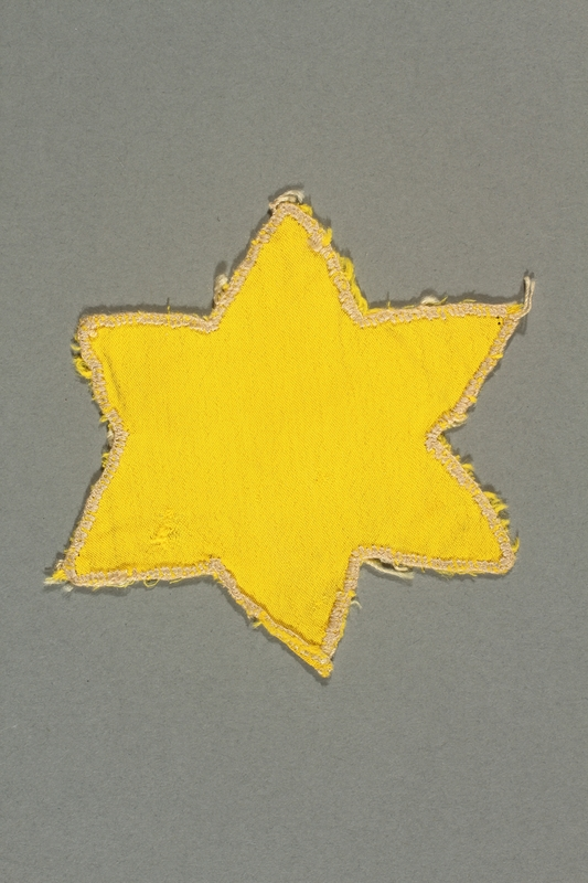 2013.468.2 front Yellow cloth Star of David badge worn by a Jewish boy in Budapest