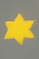 2013.468.2 front Yellow cloth Star of David badge worn by a Jewish boy in Budapest  Click to enlarge