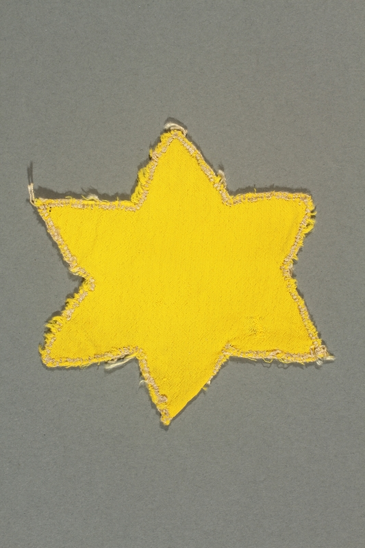 2013.468.2 back Yellow cloth Star of David badge worn by a Jewish boy in Budapest