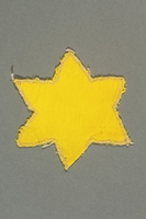 2013.468.2 back Yellow cloth Star of David badge worn by a Jewish boy in Budapest  Click to enlarge