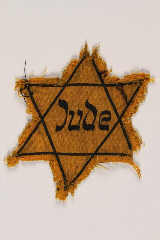 1994.3.1 front Star of David badge with Jude printed in the center