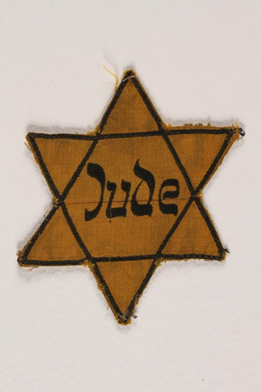 1994.41.1 front Star of David badge with Jude printed in the center