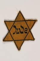 1994.41.1 front Star of David badge with Jude printed in the center  Click to enlarge