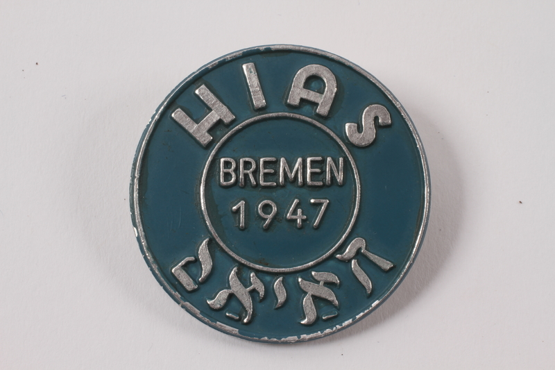 2013.474.2 front Blue and silver HIAS pin worn by a Jewish Latvian youth postwar