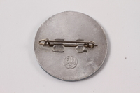2013.474.2 back Blue and silver HIAS pin worn by a Jewish Latvian youth postwar  Click to enlarge