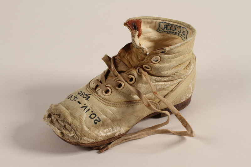 1994.53.7 b front Pair of toddler's shoes owned by a Jewish child refugee
