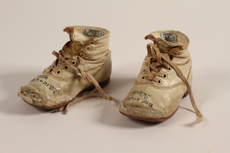 1994.53.7 a-b front Pair of toddler's shoes owned by a Jewish child refugee