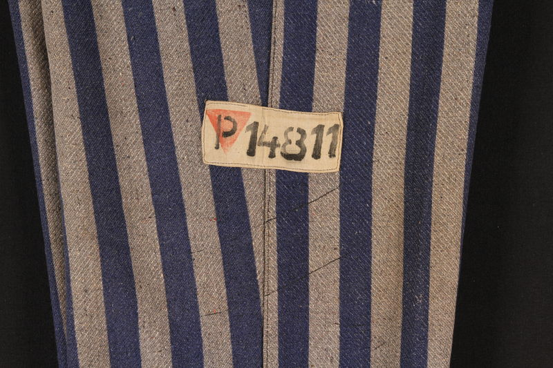 1994.55.3 detail Concentration camp uniform pants with red triangle patch worn by Polish Jewish inmate