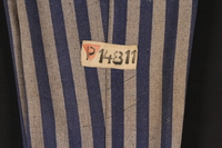 1994.55.3 detail Concentration camp uniform pants with red triangle patch worn by Polish Jewish inmate  Click to enlarge