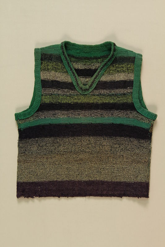 1994.55.5 front Striped sweater vest worn by a Polish Jewish concentration camp inmate