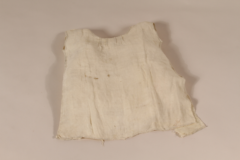 1994.56.1 front Dress worn by a child while in hiding