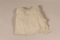 1994.56.1 front Dress worn by a child while in hiding  Click to enlarge