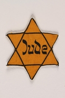 1994.6.1 front Star of David badge with Jude printed in the center  Click to enlarge
