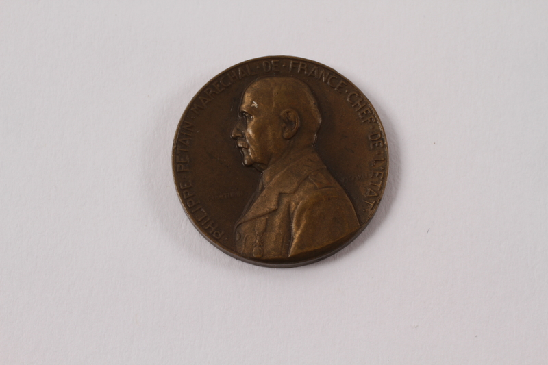 2013.478.4 front Bronze Marshal Petain medal given to a Jewish girl living as a refugee in France