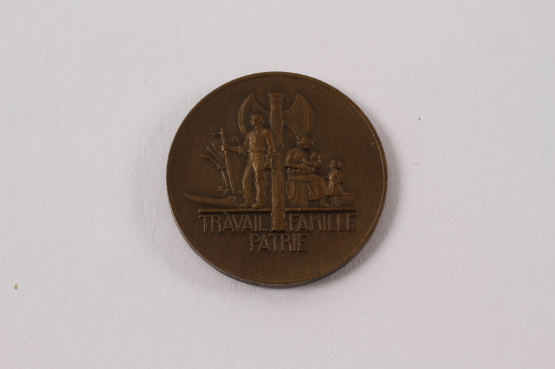 2013.478.4 back Bronze Marshal Petain medal given to a Jewish girl living as a refugee in France