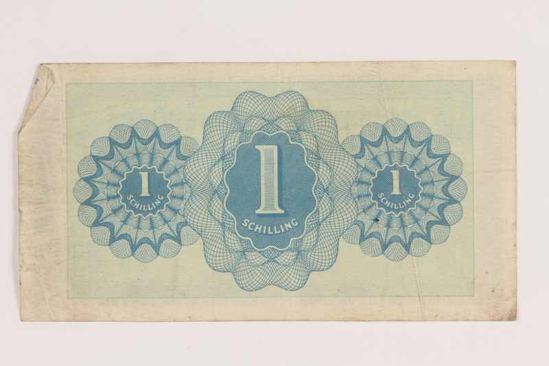 2013.442.21 back Allied Military Authority currency, 1 schilling, for use in Austria, acquired by a US soldier