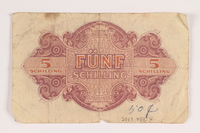 2013.483.4 back Allied Military Authority currency, 5 schilling, for use in Austria inscribed by an American soldier  Click to enlarge