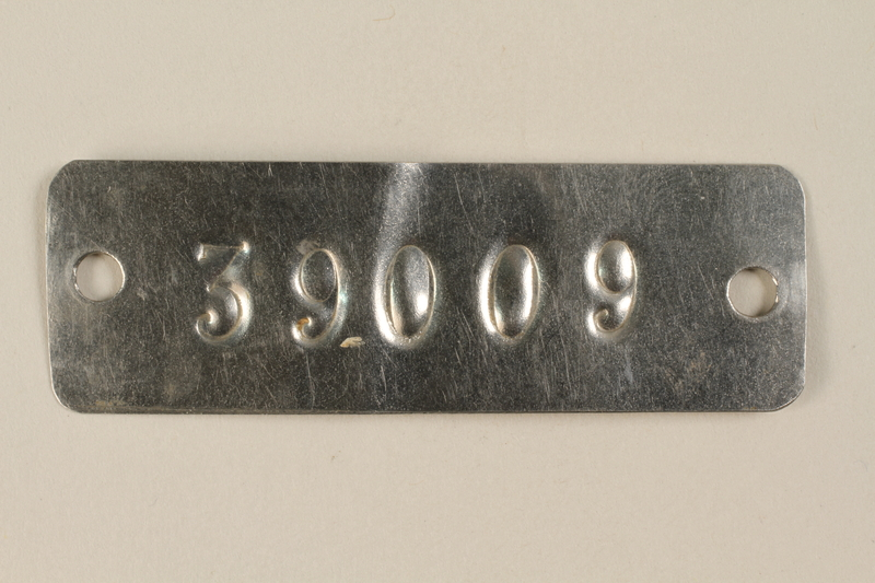 1994.74.1 front Auschwitz concentration camp metal prisoner identification tag