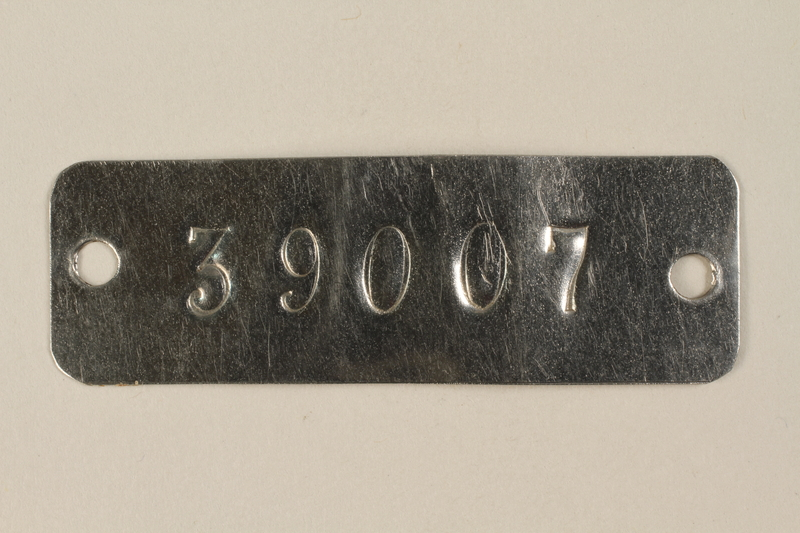 1994.74.2 front Auschwitz concentration camp metal prisoner identification tag
