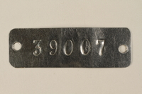 1994.74.2 front Auschwitz concentration camp metal prisoner identification tag  Click to enlarge