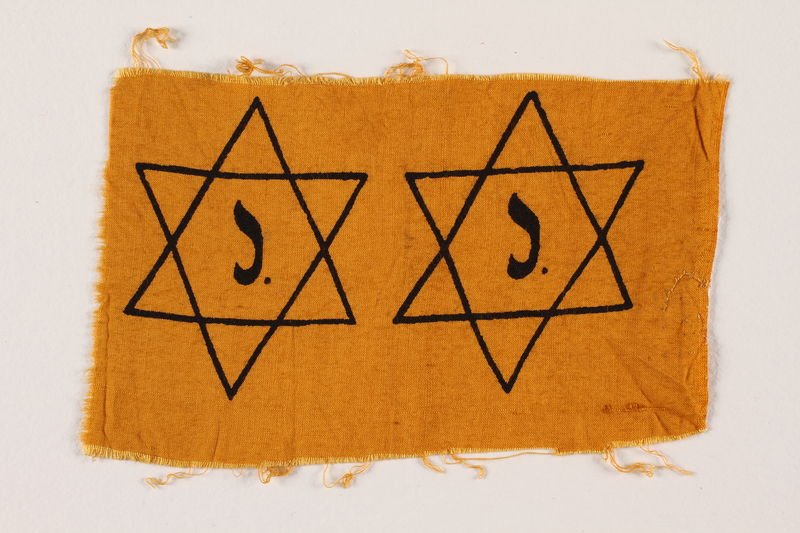 1994.9.1 front Unused yellow cloth printed with 2 Stars of David with a J to be made into badges