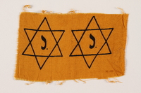 1994.9.1 front Unused yellow cloth printed with 2 Stars of David with a J to be made into badges  Click to enlarge