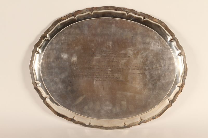 1994.97.1 back Engraved sterling silver tea tray honoring recipient's service to the URO
