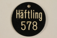 1989.173.1 front Identification tag issued to a slave laborer at the munitions factory  Click to enlarge