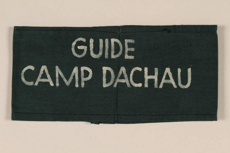 1995.105.6 front Green armband inscribed Guide Camp Dachau used by medical personnel after liberation and retrieved by a US soldier