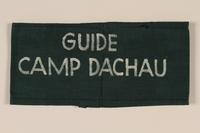1995.105.6 front Green armband inscribed Guide Camp Dachau used by medical personnel after liberation and retrieved by a US soldier  Click to enlarge