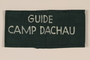 Green armband inscribed Guide Camp Dachau used by medical personnel after liberation and retrieved by a US soldier