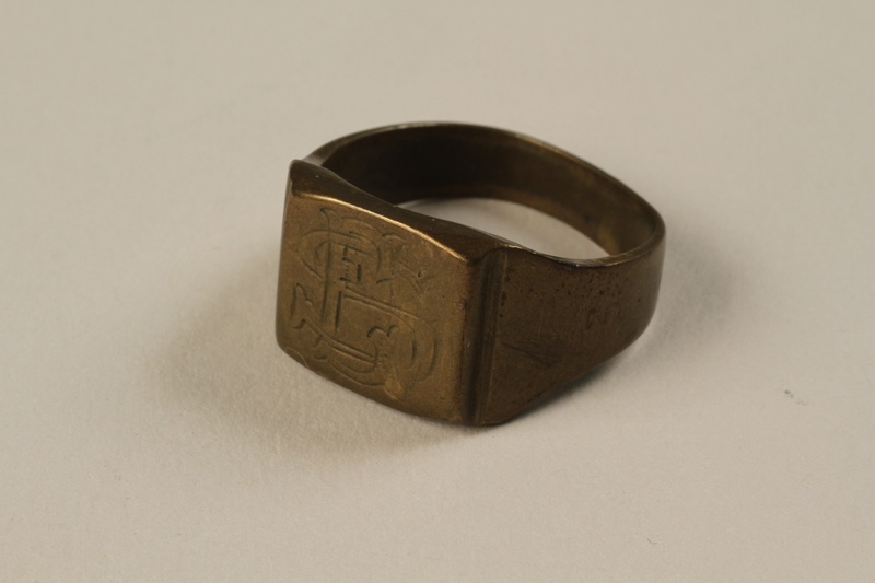 1995.105.8 front Copper finger ring with a monogram received by a US soldier at a concentration camp