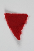 1995.105.9 front Red wool triangular inmate badge retrieved by a US soldier at a concentration camp  Click to enlarge