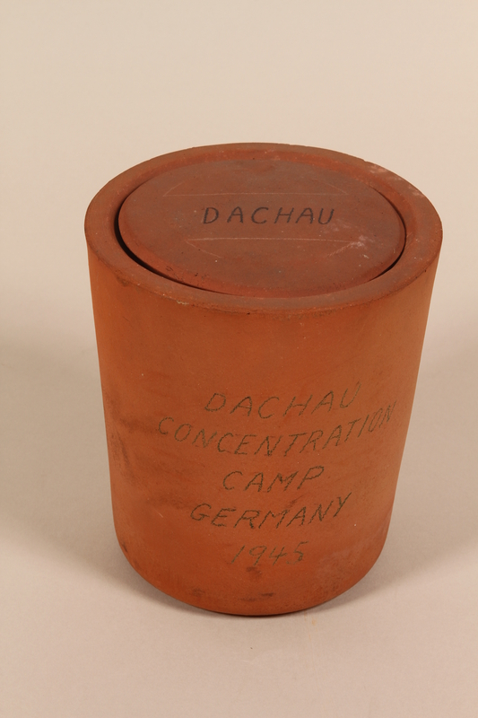 1995.106.1 a-b closed Urn found at Dachau concentration camp after liberation by a US soldier