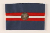 1995.111.1 front Blue armband with red and white stripes and a royal coat of arms medallion worn by a Danish resistance fighter  Click to enlarge